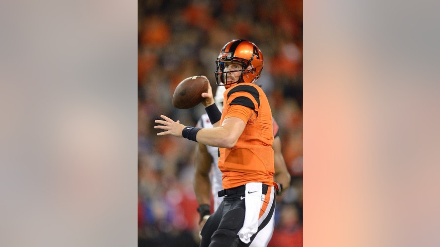 Oregon State quarterback Sean Mannion (4) passes against the University of Utah during an NCAA college football game in Corvallis, Ore., Thursday, Oct.. 16, 2014. The University of Utah beat Oregon State 29-23 in overtime. (AP Photo/Troy Wayrynen)