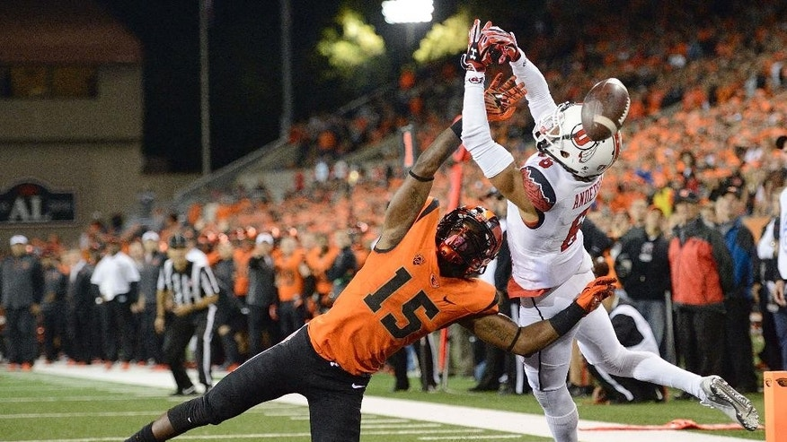 Oregon State cornerback Larry Scott breaks up a pass play intended for University of Utah receiver Dres Anderson during an NCAA college football game in Corvallis, Ore., Thursday, Oct.. 16, 2014. The University of Utah beat Oregon State 29-23 in overtime. (AP Photo/Troy Wayrynen)
