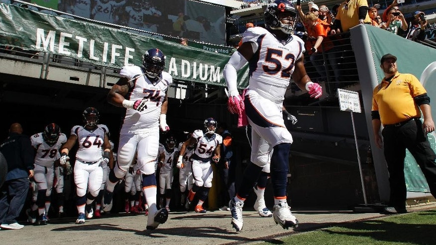 In this Oct. 12, 2014, photo, Denver Broncos linebacker Corey Nelson (52) runs out onto the field with teammates before playing against the New York Jets in an NFL football game in East Rutherford, N.J. Nelson led the star-studded Broncos in tackles last week after weakside linebacker Danny Trevathan left the game against the New York Jets with a broken left leg. (AP Photo/Kathy Willens)