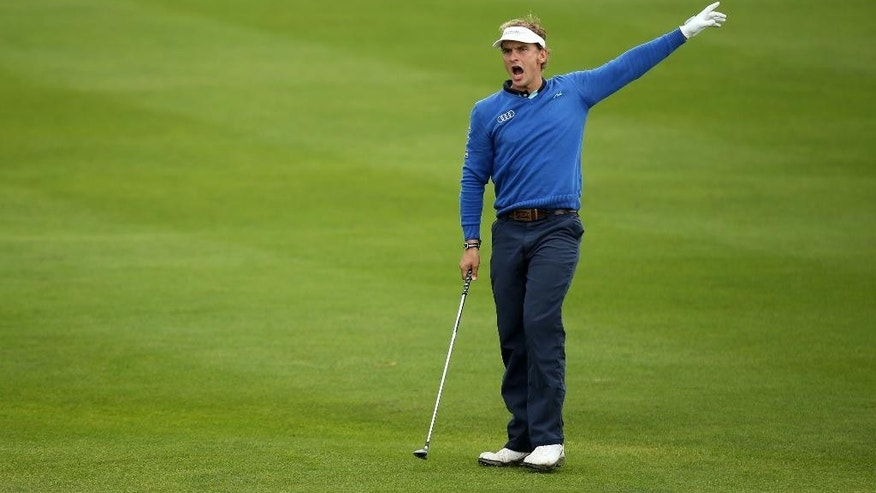 Joost Luiten of the Netherlands, shouts to the crowd after hitting his ball into the rough on the 13th hole during day three of the World Match Play Championship at The London Golf Club in Ash, England, Friday Oct. 17, 2014. (AP Photo/PA, John Walton) UNITED KINGDOM OUT  NO SALES  NO ARCHIVE