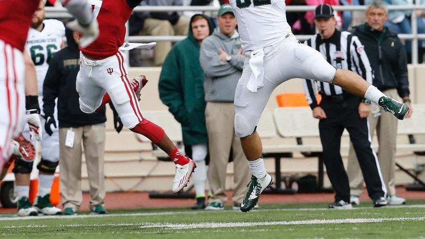Michigan State tight end Josiah Price (82) hauls in a pass against Indiana in the first half of an NCAA college football game in Bloomington, Ind., Saturday, Oct. 18, 2014. (AP Photo/Sam Riche)