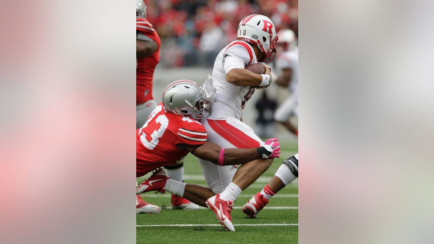 Ohio State linebacker Darron Lee, left, sacks Rutgers quarterback Gary Nova during the second quarter of an NCAA college football game Saturday, Oct. 18, 2014, in Columbus, Ohio. (AP Photo/Jay LaPrete)