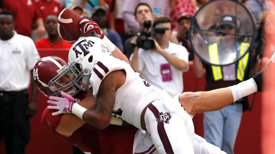 Texas A&M defensive back Howard Matthews, right, breaks up a pass intended for Alabama tight end Brian Vogler (84) in the end zone during the first half of an NCAA college football game on Saturday, Oct. 18, 2014, in Tuscaloosa, Ala. (AP Photo/Butch Dill)