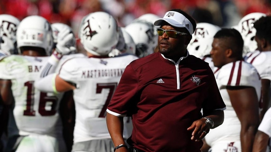 Texas A&M head coach Kevin Sumlin walks the sideline during the first half of an NCAA college football game against Alabama, Saturday, Oct. 18, 2014, in Tuscaloosa, Ala. (AP Photo/Butch Dill)
