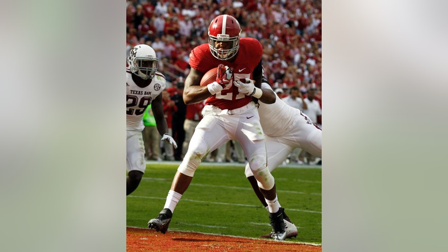 Alabama running back Derrick Henry (27) runs in for a touchdown during the first half of an NCAA college football game against Texas A&M, Saturday, Oct. 18, 2014, in Tuscaloosa, Ala. (AP Photo/Butch Dill)