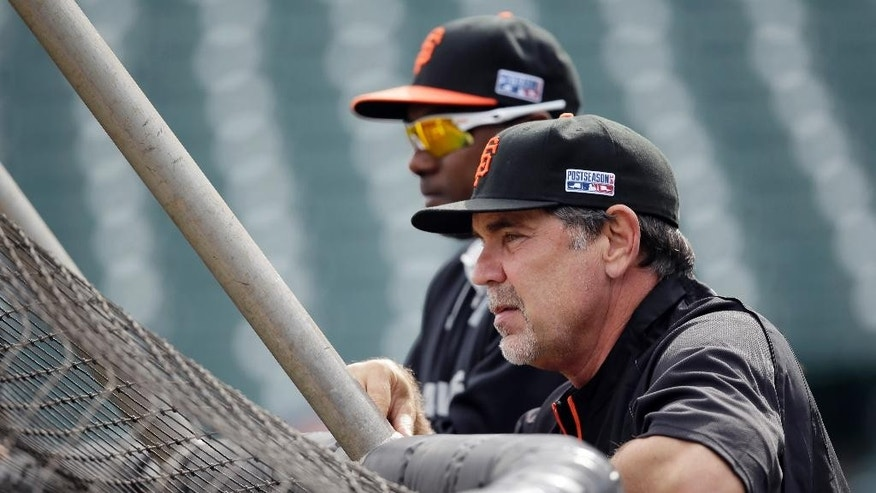 San Francisco Giants manager Bruce Bochy, watches during batting practice before Game 4 of the National League baseball championship series against the St. Louis Cardinals Wednesday, Oct. 15, 2014, in San Francisco. (AP Photo/Eric Risberg)