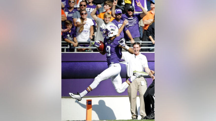 Fans cheer as TCU wide receiver Josh Doctson (9) sprints into the end zone for a touchdown in the first  half of an NCAA college football game against Oklahoma State, Saturday, Oct. 18, 2014, in Fort Worth, Texas. (AP Photo/Tony Gutierrez)