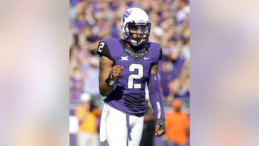 TCU quarterback Trevone Boykin (2) pumps his fist after completing a pass against Oklahoma State in the first half of an NCAA college football game, Saturday, Oct. 18, 2014, in Fort Worth, Texas. (AP Photo/Tony Gutierrez)