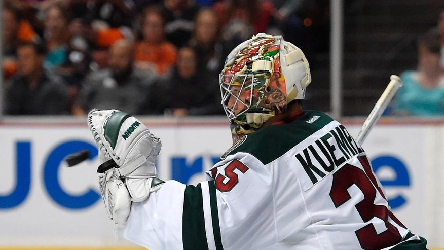 Minnesota Wild goalie Darcy Kuemper makes a glove save during the second period an NHL hockey game against the Anaheim Ducks, Friday, Oct. 17, 2014, in Anaheim, Calif. (AP Photo/Mark J. Terrill)