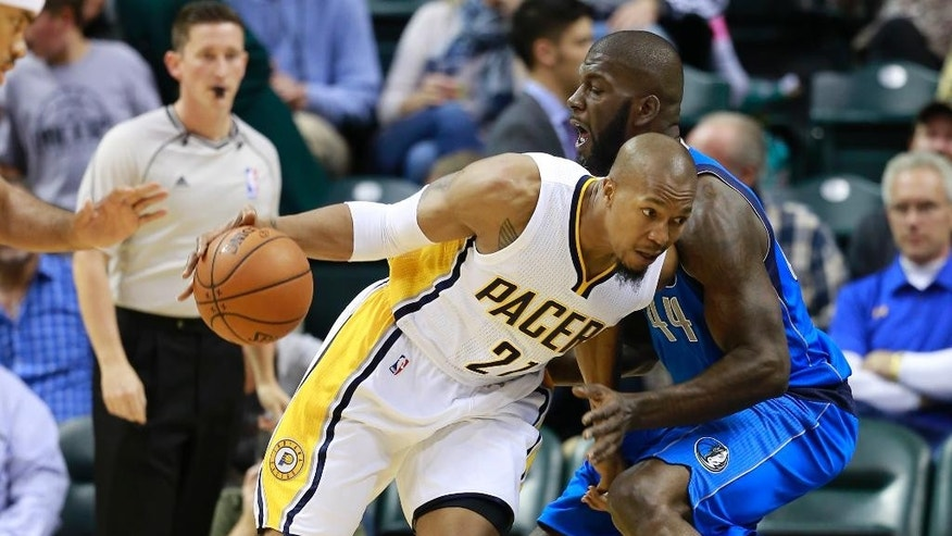 Indiana Pacers forward David West, left, drives into Dallas Mavericks forward Ivan Johnson in the first half of a preseason NBA basketball game in Indianapolis, Saturday, Oct. 18, 2014.  (AP Photo/R Brent Smith)