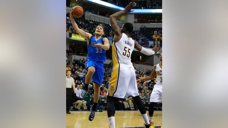 Dallas Mavericks guard Gal Mekel (33) puts up a shot defended by Indiana Pacers center Roy Hibbert in the first half of a preseason NBA basketball game in Indianapolis, Saturday, Oct. 18, 2014.  (AP Photo/R Brent Smith)