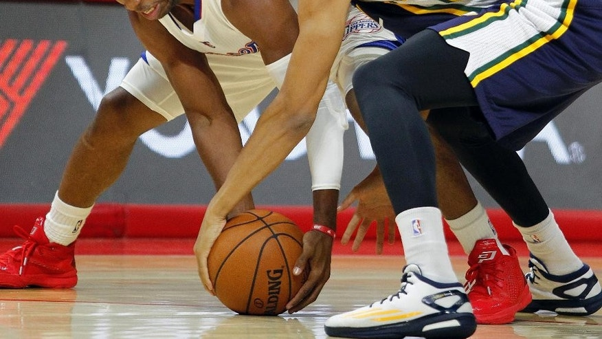Los Angeles Clippers guard Chris Paul, left, and Utah Jazz guard Dante Exum (11), of Australia, scramble for the ball during the first half of an NBA preseason basketball game Friday, Oct. 17, 2014, in Los Angeles. (AP Photo/Alex Gallardo)