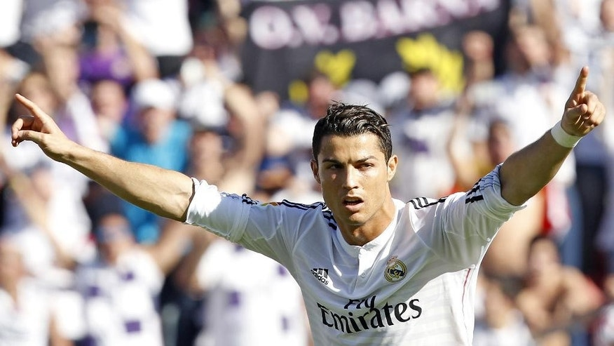 Real Madrid's Cristiano Ronaldo from Portugal celebrates scoring against Levante during a Spanish La Liga soccer match at the Ciutat de Valencia stadium in Valencia, Spain, on Saturday, Oct. 18, 2014. (AP Photo/Alberto Saiz)