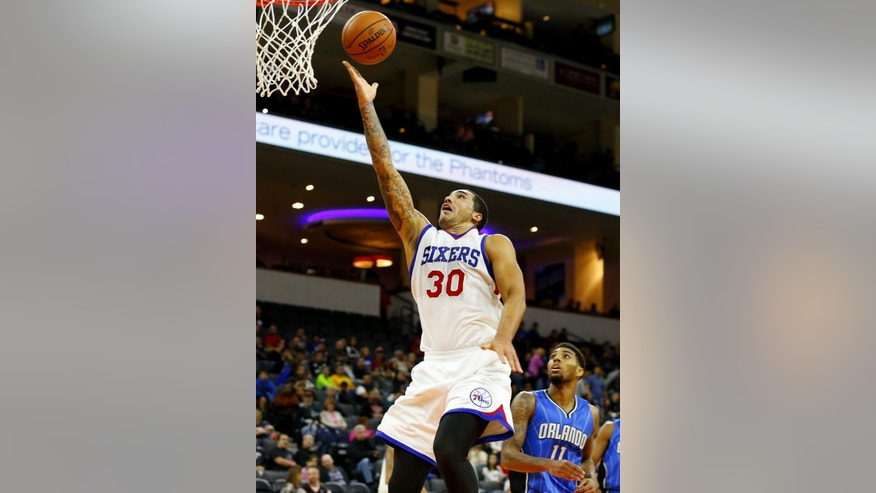 Philadelphia 76ers' Drew Gordon (30) takes a shot against the Orlando Magic during the second half of an NBA pre-season basketball game in Allentown, Pa., Saturday, Oct. 18, 2014. The 76ers defeated the Magic 95-84. (AP Photo/Rich Schultz)