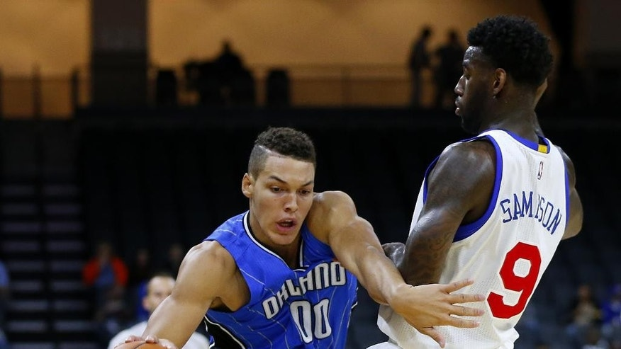 CORRECTS YEAR TO 2014 -  Orlando Magic's Aaron Gordon (00) attempts to get past Philadelphia 76ers' JaKarr Sampson (9) during the first half of an NBA pre-season basketball game in Allentown, Pa., Saturday, Oct. 18, 2014. (AP Photo/Rich Schultz)