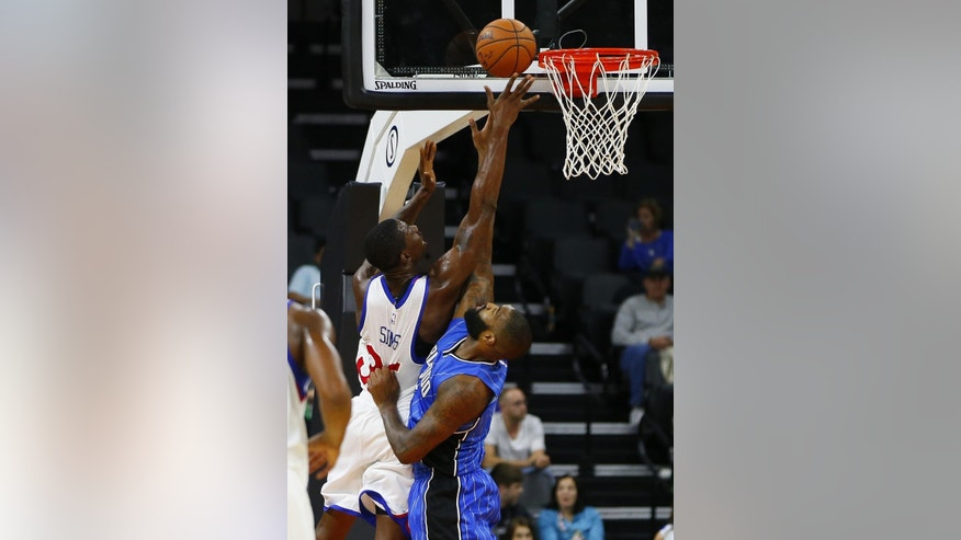 CORRECTS YEAR TO 2014 - Philadelphia 76ers' Henry Sims (35) fights Orlando Magic's Kyle O'Quinn (2) for a rebound during the first half of an NBA pre-season basketball game in Allentown, Pa., Saturday, Oct. 18, 2014. (AP Photo/Rich Schultz)