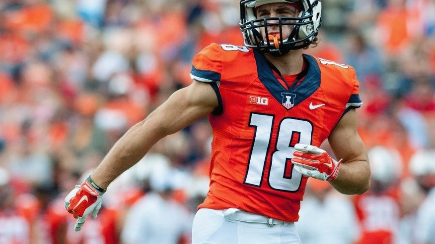 FILE - In this Sept. 6, 2014, file photo, Illinois wide receiver Mike Dudek takes his position before a snap during an NCAA college football game against Western Kentucky in Champaign, Ill. In a season in which doubts about where the next win will come from and whether coach Tim Beckman will keep his job dominate the discussion, Illinois can say this: In Dudek and Geronimo Allison they have a pair of receivers that no Big Ten team can quite match. (AP Photo/Bradley Leeb, File)