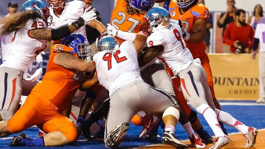 Boise State running back Jay Ajayi (27) just manages to break the plane for a touchdown during the first half of an NCAA college football game against Fresno State in Boise, Idaho, on Friday, Oct. 17, 2014. (AP Photo/Otto Kitsinger)