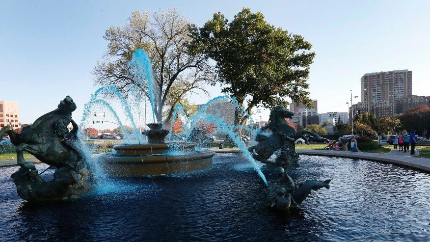 A fountain on the Country Club Plaza is dyed blue in celebration of the Kansas City Royals success in Kansas City, Mo., Friday, Oct. 17, 2014. The Royals are making their first World Series appearance in 29 years. (AP Photo/Orlin Wagner)