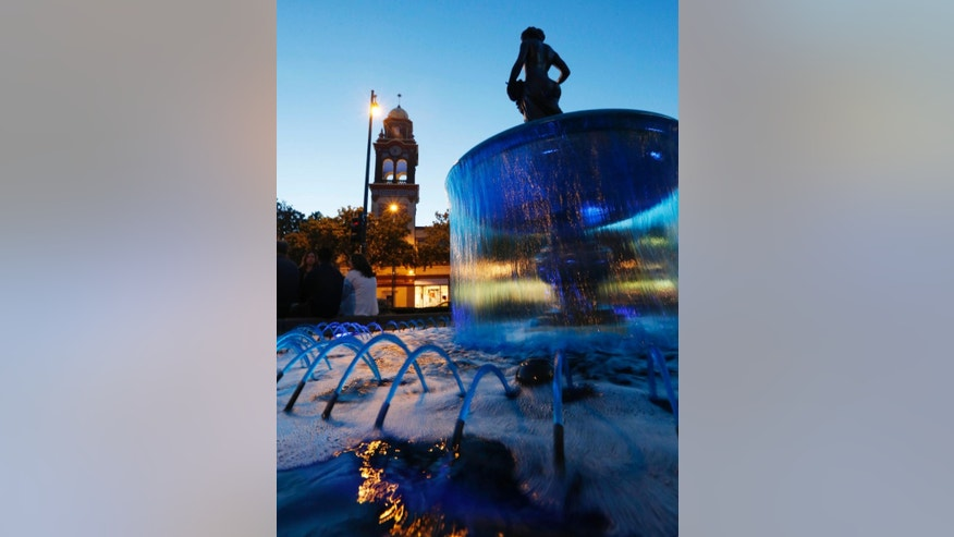 Water in a fountain on the Country Club Plaza is dyed blue in celebration of the Kansas City Royals' success, in Kansas City, Mo., Friday, Oct. 17, 2014. The Royals are making their first World Series appearance in 29 years. (AP Photo/Orlin Wagner)