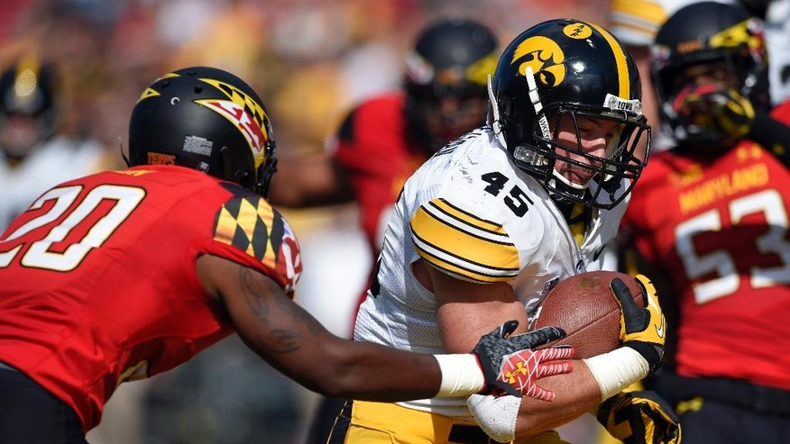 Iowa running back Mark Weisman (45) runs past Maryland defensive back Anthony Nixon (20) en route to scoring a touchdown during the first half of an NCAA college football game, Saturday, Oct. 18, 2014, in College Park, Md. (AP Photo/Nick Wass)