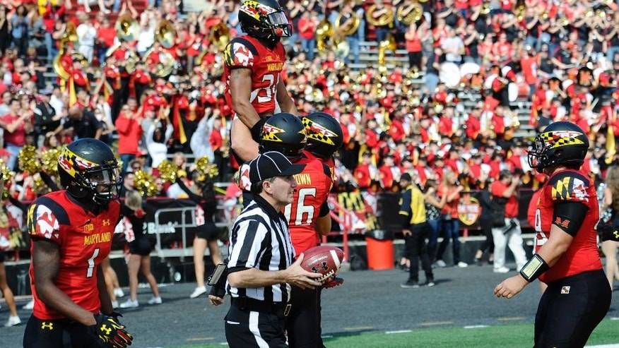 Maryland wide receiver Jacquille Veii (34) celebrates his touchdown against Iowa during the first half of an NCAA college football game, Saturday, Oct. 18, 2014, in College Park, Md. (AP Photo/Nick Wass)