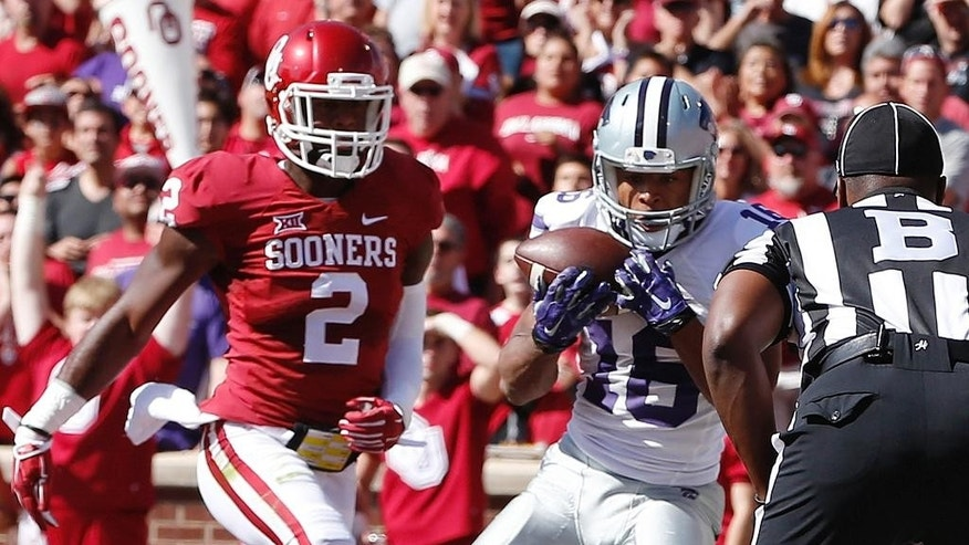 Kansas State wide receiver Tyler Lockett (16) catches a pass for a touchdown in front of Oklahoma cornerback Julian Wilson (2) in the second quarter of an NCAA college football game in Norman, Okla., Saturday, Oct. 18, 2014. (AP Photo/Sue Ogrocki)