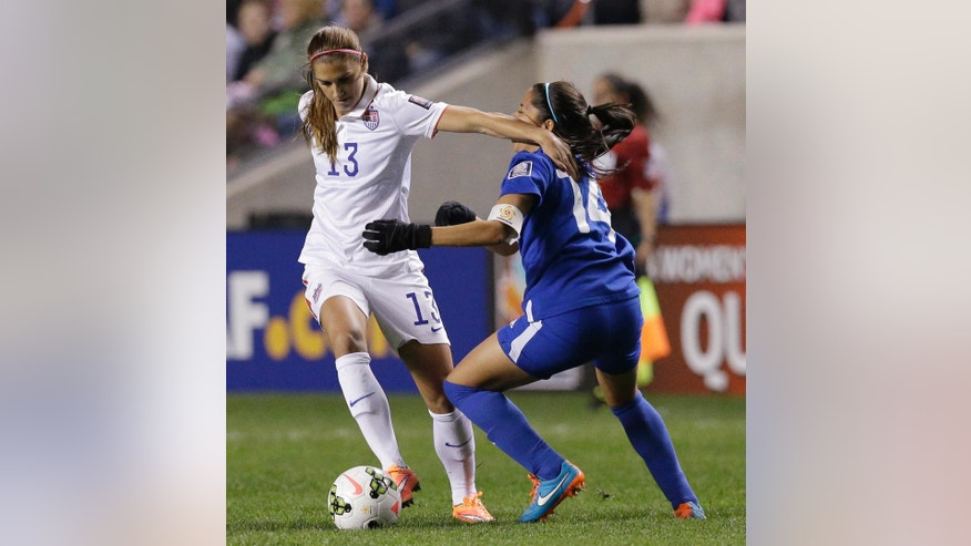 United States' Alex Morgan, left, controls the ball against Guatemala's Coralia Monterroso during the first half of a CONCACAF Women's Championship soccer game Friday, Oct. 17, 2014, in Bridgeview, Ill. (AP Photo/Nam Y. Huh)