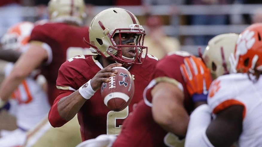 Boston College quarterback Tyler Murphy (2) passes out of the pocket during the first quarter of an NCAA college football game against Clemson, Saturday, Oct. 18, 2014, in Boston. (AP Photo/Stephan Savoia)
