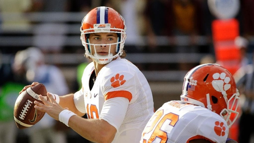 Clemson quarterback Cole Stoudt (18) drops back to pass during the first quarter of an NCAA college football game against Boston College, Saturday, Oct. 18, 2014, in Boston. (AP Photo/Stephan Savoia)