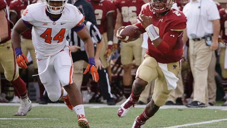 Boston College quarterback Tyler Murphy (2) scrambles out of the pocket as he is chased by Clemson linebacker B.J. Goodson (44) during the first quarter of an NCAA college football game Saturday, Oct. 18, 2014, in Boston. (AP Photo/Stephan Savoia)