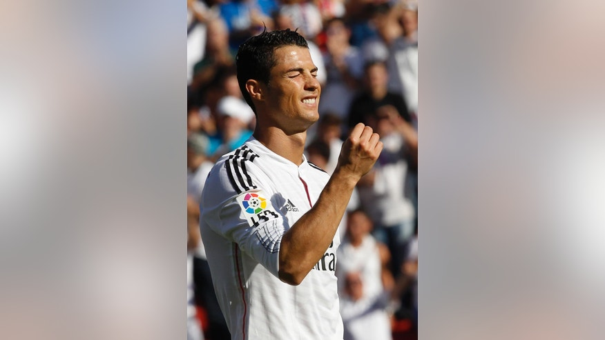 Real Madrid's Cristiano Ronaldo reacts after failing to score against Levante during a Spanish La Liga soccer match at the Ciutat de Valencia stadium in Valencia, Spain, on Saturday, Oct. 18, 2014.(AP Photo/Alberto Saiz)
