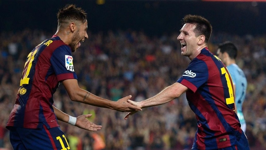 FC Barcelona's Lionel Messi, from Argentina, right, reacts after scoring with his teammate Neymar, from Brazil, during a Spanish La Liga soccer match at the Camp Nou stadium against Eibar in Barcelona, Spain, Saturday, Oct. 18, 2014. (AP Photo/Manu Fernandez)
