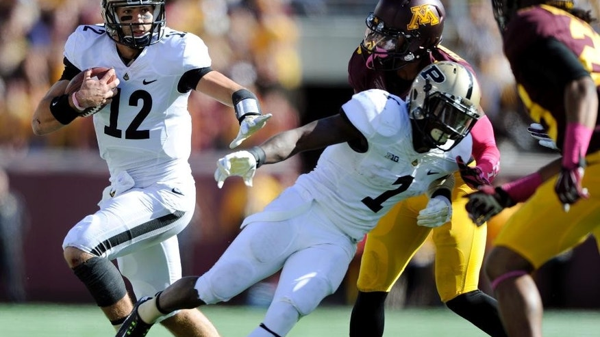 Purdue quarterback Austin Appleby (12) carries the football against Minnesota during the second quarter of an NCAA college football game Saturday, Oct. 18, 2014, in Minneapolis. (AP Photo/Hannah Foslien)
