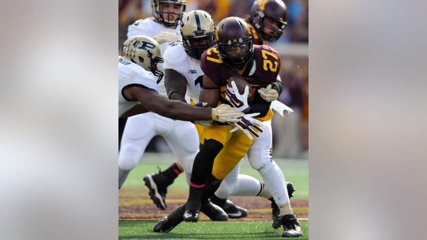 Purdue linebacker Gelen Robinson, left, and defensive tackle Ra'Zahn Howard bring down Minnesota running back David Cobb (27) during the first quarter of an NCAA college football game Saturday, Oct. 18, 2014, in Minneapolis. (AP Photo/Hannah Foslien)