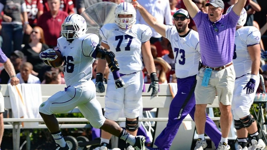 Furman running back Hank McCloud runs down the sidelines for a touchdown during an NCAA college football game against South Carolina in Columbia, S.C.,  Saturday, Oct. 17, 2014. (AP Photo/ Richard Shiro)
