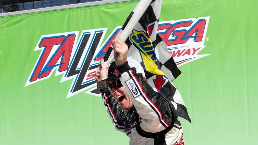 Timothy Peters reacts after winning the NASCAR Camping Truck series auto race at Talladega Superspeedway, Saturday, Oct. 18, 2014, in Talladega, Ala. (AP Photo/John Bazemore)