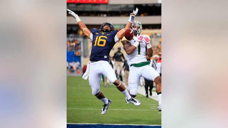 West Virginia's Terrell Chestnut (16) knocks down a pass intended for Baylor's Corey Coleman (1) during the first quarter of an NCAA college football game in Morgantown, W.Va., Saturday, Oct. 18, 2014. (AP Photo/Chris Jackson)