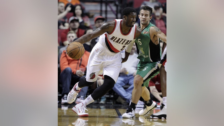 Portland Trail Blazers guard Wesley Matthews, left, drives around Maccabi Haifa guard Brody Angley during the first half of an NBA exhibition basketball game in Portland, Ore., Friday, Oct. 17, 2014. (AP Photo/Don Ryan)