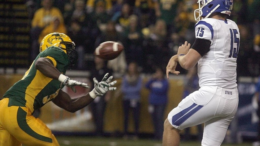 North Dakota State linebacker Carlton Littlejohn, left, rushes Indiana State quarterback Mike Perish during an NCAA college football game, Saturday, Oct. 18, 2014, in Fargo, N.D. (AP Photo/Bruce Crummy)