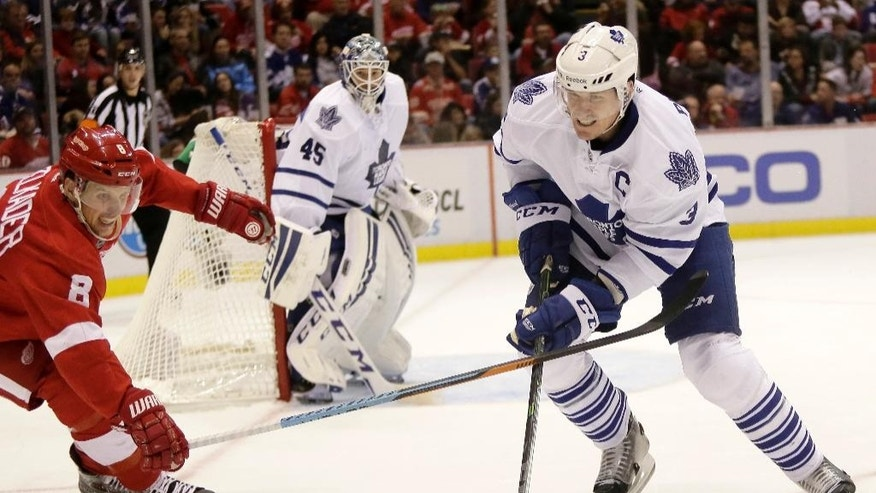 Detroit Red Wings' Justin Abdelkader (8) tries to steal the puck from Toronto Maple Leafs' Dion Phaneuf (3) during the second period of an NHL hockey games Saturday, Oct. 18, 2014, in Detroit. (AP Photo/Duane Burleson)