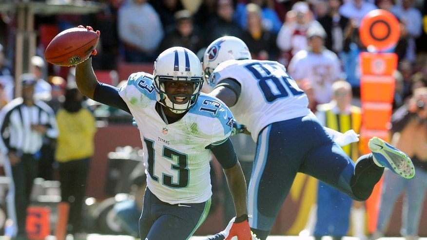 Tennessee Titans wide receiver Kendall Wright (13) celebrates his touchdown during the first half of an NFL football game against the Washington Redskins, Sunday, Oct. 19, 2014, in Landover, Md. (AP Photo/Richard Lipski)