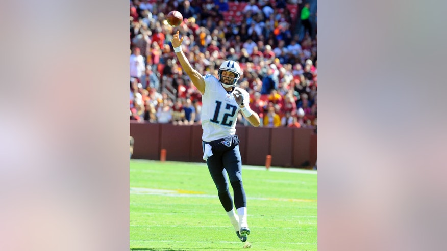 Tennessee Titans quarterback Charlie Whitehurst (12) throws a pass during the first half of an NFL football game against the Washington Redskins, Sunday, Oct. 19, 2014, in Landover, Md. (AP Photo/Richard Lipski)