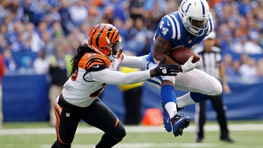 Indianapolis Colts running back Ahmad Bradshaw (44) is tackled by Cincinnati Bengals free safety Reggie Nelson (20) during the second half of an NFL football game Sunday, Oct. 19, 2014, in Indianapolis. (AP Photo/AJ Mast)