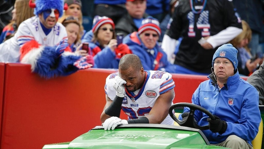 Fans cheer as Buffalo Bills running back Fred Jackson (22) is carted off the field during the first half of an NFL football game against the Minnesota Vikings, Sunday, Oct. 19, 2014, in Orchard Park, N.Y.  (AP Photo/Bill Wippert)