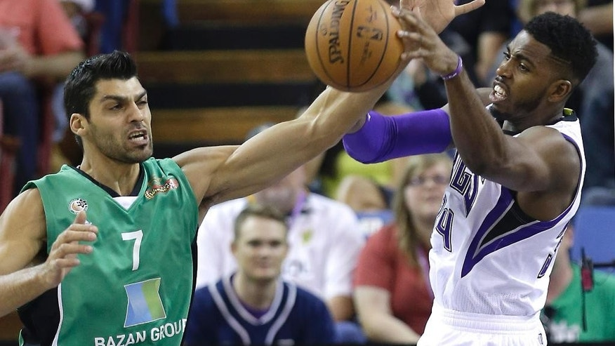 Maccabi Haifa center Alex Chubrevich, left, and Sacramento Kings forward Jason Thompson reach for a rebound during the first quarter of an NBA exhibition basketball game in Sacramento, Calif., Saturday, Oct. 18, 2014. (AP Photo/Rich Pedroncelli)