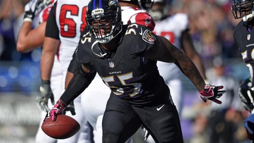Baltimore Ravens outside linebacker Terrell Suggs celebrates after sacking Atlanta Falcons quarterback Matt Ryan in the end zone for a safety in the second half of an NFL football game, Sunday, Oct. 19, 2014, in Baltimore. (AP Photo/Nick Wass)