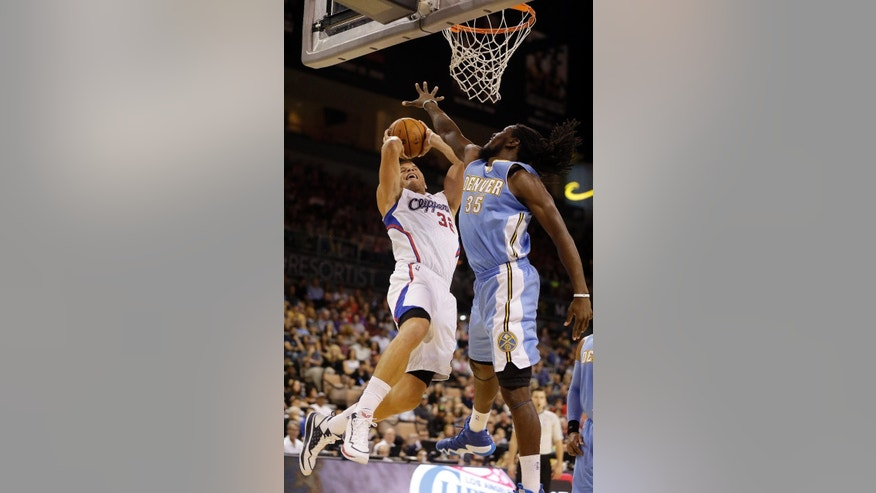 Denver Nuggets forward Kenneth Faried (35) covers a shot from Los Angeles Clippers forward Blake Griffin (32) during the first half of an NBA preseason basketball game Saturday, Oct. 18, 2014, in Las Vegas. (AP Photo/Isaac Brekken)