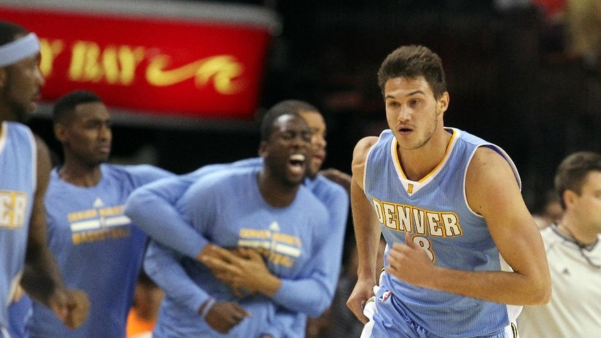 The Denver Nuggets bench reacts after forward Danilo Gallinari, right, dunked during the first half of an NBA preseason basketball game against the Los Angeles Clippers on Saturday, Oct. 18, 2014, in Las Vegas. (AP Photo/Isaac Brekken)