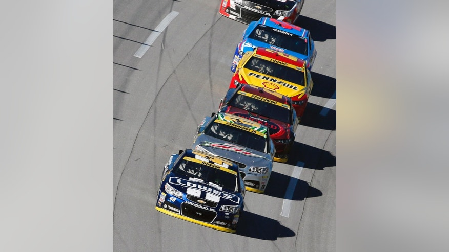 Jimmie Johnson (48) leads Dale Earnhardt Jr. (88), Brad Keselowski (2) and Joey Logano (22) during the NASCAR Sprint Cup Series auto race at Talladega Superspeedway, Sunday, Oct. 19, 2014, in Talladega, Ala. (AP Photo/Butch Dill)